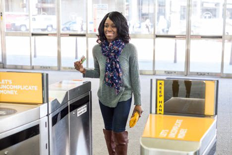 Customer scanning into a fare gate