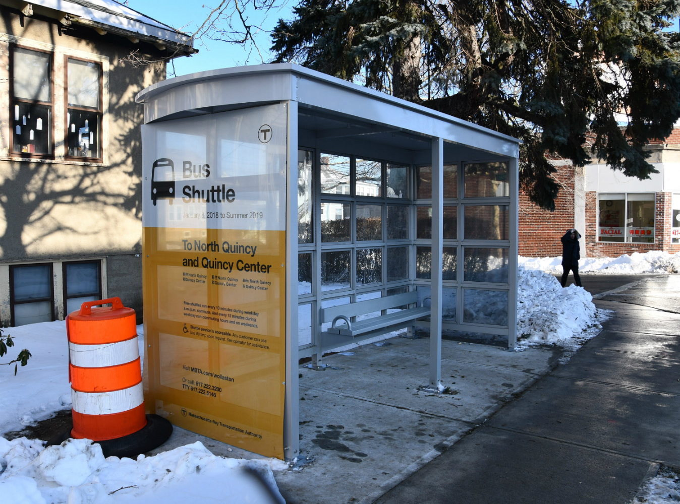 New bus shelter with snow in the background.