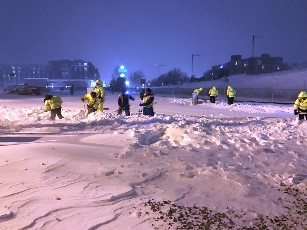 orange-line-shoveling-crew.jpg